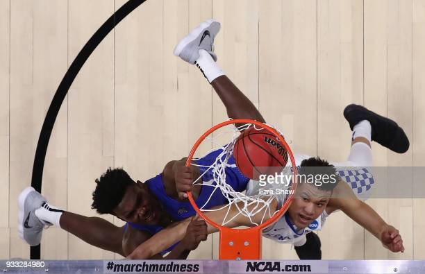 Nick Perkins of the Buffalo Bulls dunks the ball against Kevin Knox of the Kentucky Wildcats in the second round of the 2018 NCAA Men's Basketball...