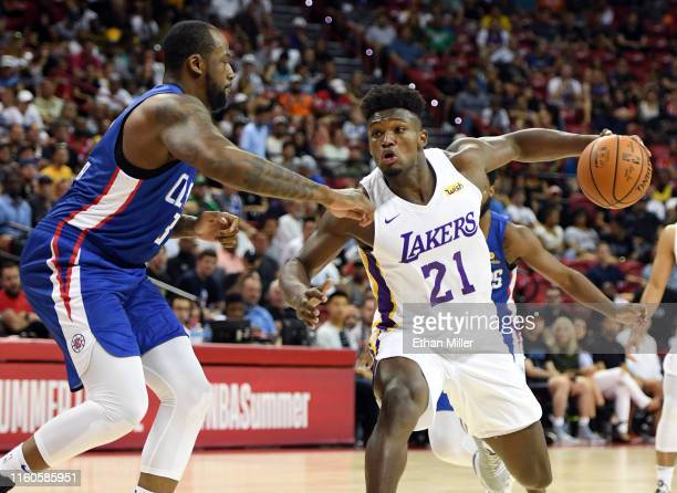 Nick Perkins of the Los Angeles Lakers drives against Cliff Alexander of the LA Clippers during the 2019 NBA Summer League at the Thomas Mack Center...