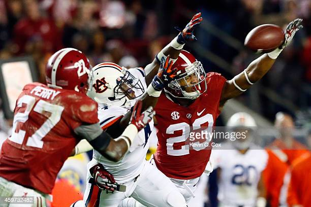 Nick Perry of the Alabama Crimson Tide intercepts a pass intended for Quan Bray of the Auburn Tigers thrown by Nick Marshall in the fourth quarter...