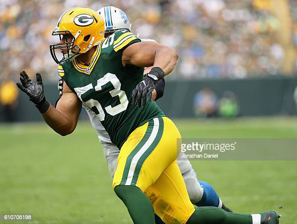 BAY WI SEPTEMBER 25 Nick Perry of the Green Bay Packers rushes past Cornelius Lucas of the Detroit Lions at Lambeau Field on September 25 2016 in...