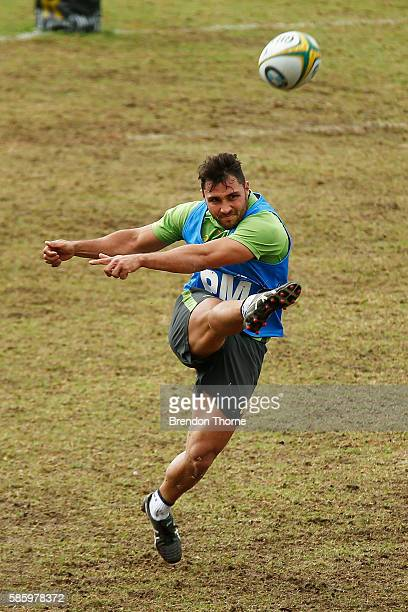 Nick Phipps kicks during an Australian Wallabies media opportunity at Weigall Sports Ground on August 5 2016 in Sydney Australia