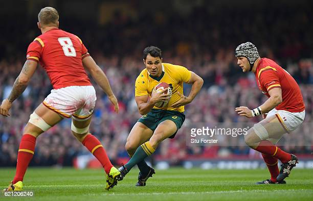 Nick Phipps of Australia is challenged by Ross Moriarty and Dan Lydiate of Wales during the international match between Wales and Australia at the...