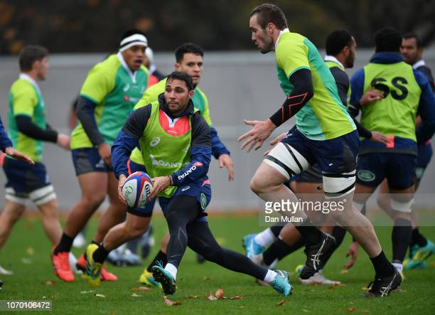 Nick Phipps of Australia looks for a pass with support from Izack Rodda of Australia during a training session at the Lensbury on November 20 2018 in...