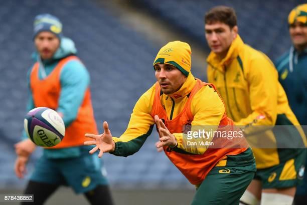 Nick Phipps of Australia passes the ball during the Australia Captain's Run at Murrayfield Stadium on November 24 2017 in Edinburgh Scotland