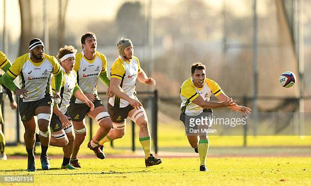 Nick Phipps of Australia releases a pass during an Australia training session at Harrow School on November 29 2016 in London United Kingdom