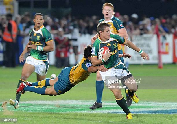 Nick Phipps of Australia tackles JW Jonker of South Africa during the International match between South Africa and Australia at the Sevens Stadium on...
