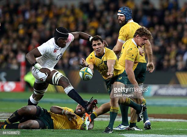 Nick Phipps of the Wallabies passes the ball during the International Test match between the Australian Wallabies and England at AAMI Park on June 18...