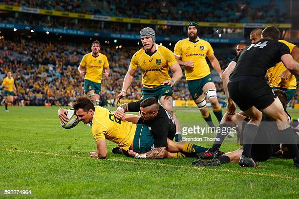 Nick Phipps of the Wallabies scores a try during the Bledisloe Cup Rugby Championship match between the Australian Wallabies and the New Zealand All...