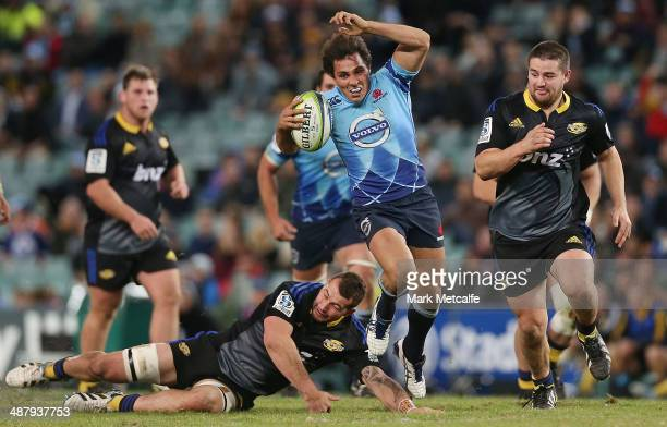 Nick Phipps of the Waratahs breaks through a tackle during the round 12 Super Rugby match between the Waratahs and the Hurricanes at Allianz Stadium...