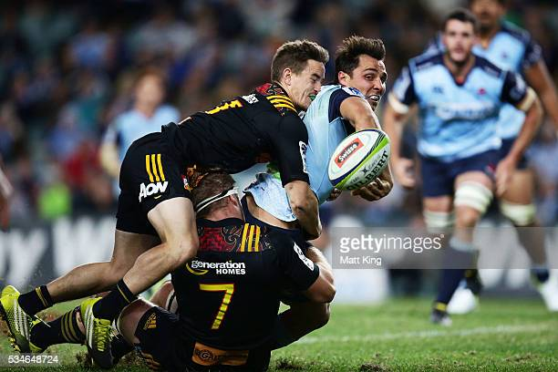 Nick Phipps of the Waratahs sets up a try to Israel Folau with an offload during the round 14 Super Rugby match between the Waratahs and the Chiefs...