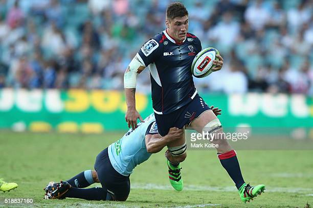 Nick Phipps of the Waratahs tackles Sean McMahon of the Rebels during the round six Super Rugby match between the New South Wales Waratahs and the...