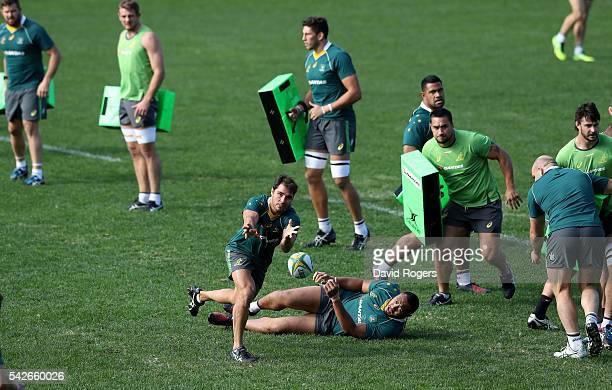 Nick Phipps passes the ball during an Australian Wallabies captain's run at Allianz Stadium on June 24 2016 in Sydney Australia