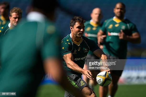 Nick Phipps passes the ball during an Australian Wallabies captain's run at ANZ Stadium on August 19 2016 in Sydney Australia