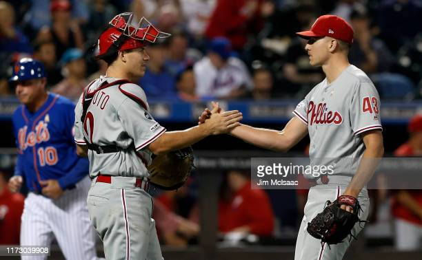 Nick Pivetta and J.T. Realmuto of the Philadelphia Phillies celebrate after defeating the New York Mets at Citi Field on September 07, 2019 in New...