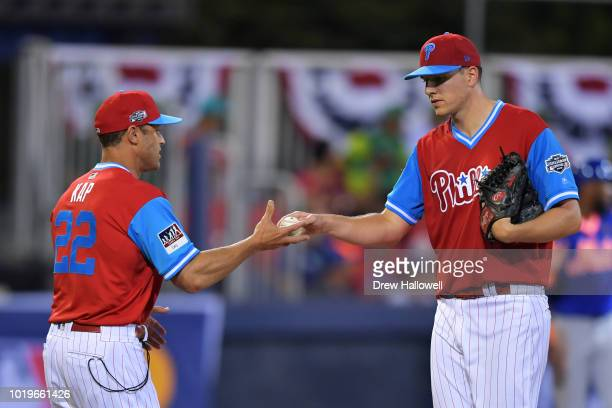 Nick Pivetta of the Philadelphia Phillies hands the ball to manager Gabe Kapler in the fourth inning against the New York Mets during the MLB Little...