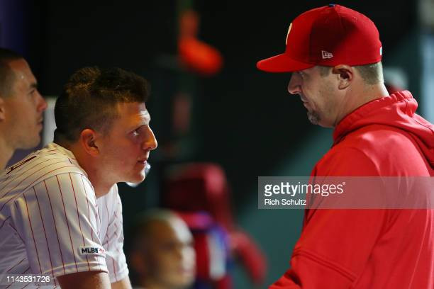Nick Pivetta of the Philadelphia Phillies talks with pitching coach Chris Young in the dugout during a game against the New York Mets at Citizens...
