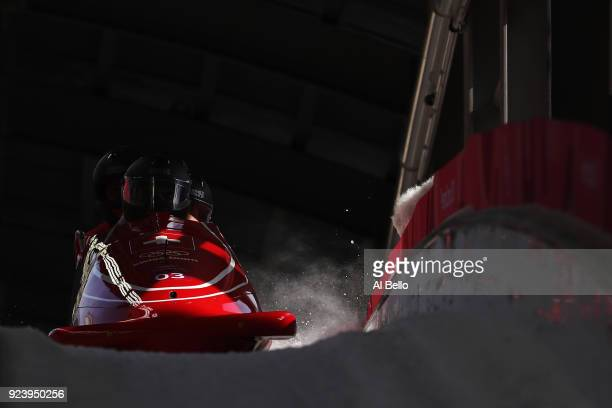 Nick Poloniato Cameron Stones Joshua Kirkpatrick and Ben Coakwell of Canada finish their final run during the 4man Boblseigh Heats on day sixteen of...