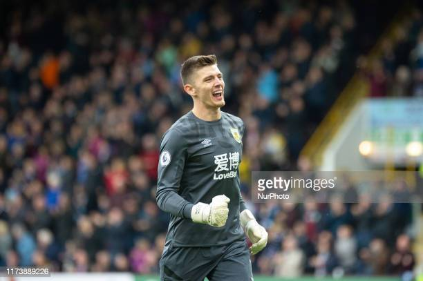 Nick Pope celebrates as Jeff Hendrick of Burnley scores his team's first goal during the Premier League match between Burnley and Everton at Turf...