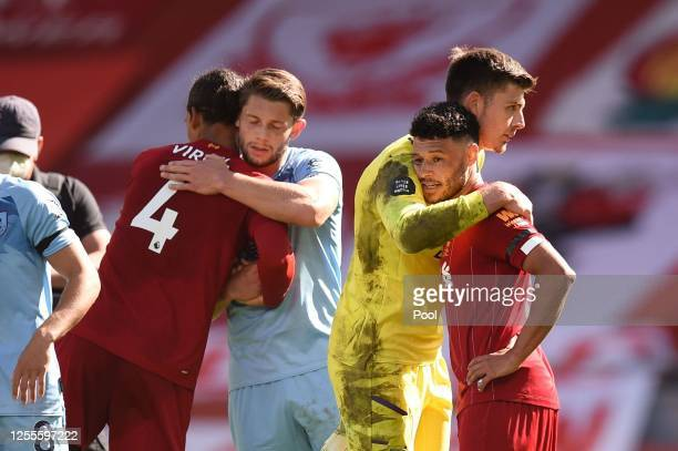 Nick Pope of Burnley and Alex OxladeChamberlain of Liverpool embrace following the Premier League match between Liverpool FC and Burnley FC at...