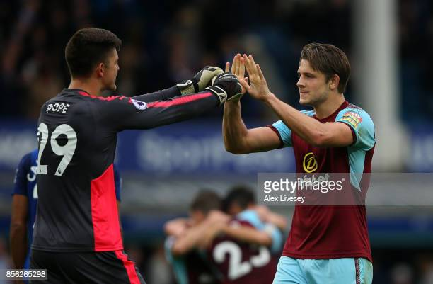 Nick Pope of Burnley and James Tarkowski of Burnley celebrate victory together after the Premier League match between Everton and Burnley at Goodison...