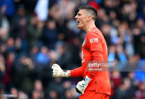 Nick Pope of Burnley celebrates after his team's third goal during the Premier League match between Burnley FC and Southampton FC at Turf Moor on...