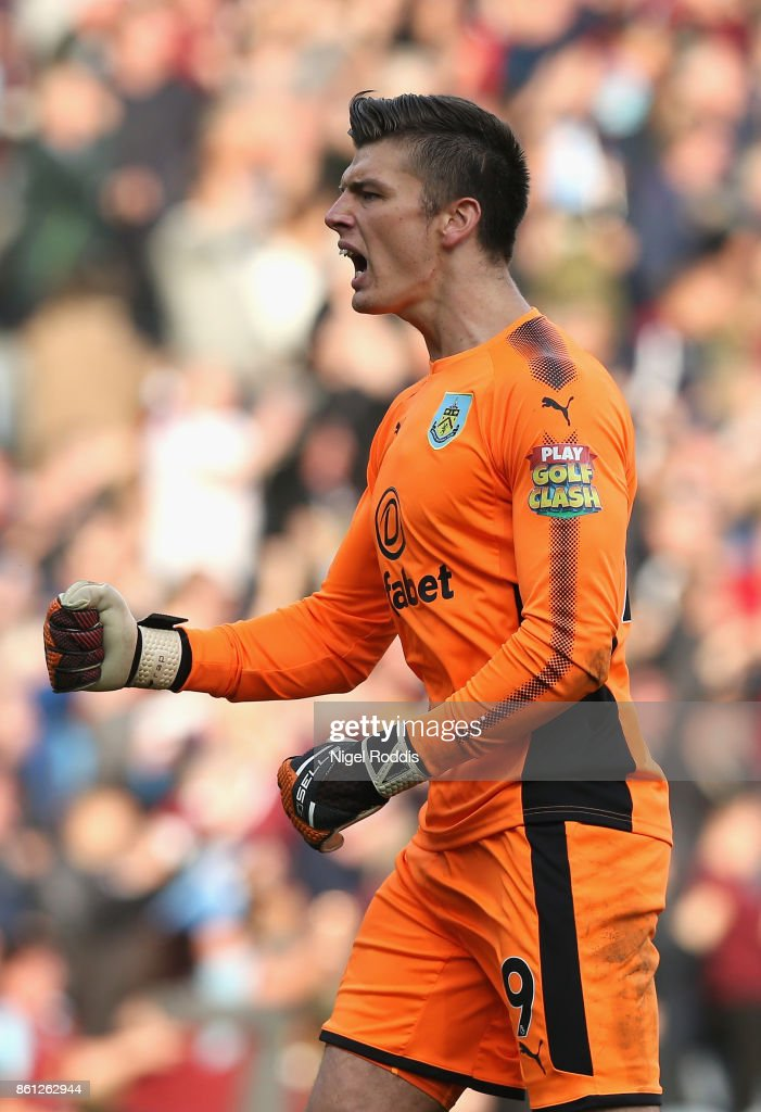 Nick Pope of Burnley celebrates during the Premier League match between Burnley and West Ham United at Turf Moor on October 14, 2017 in Burnley, England.