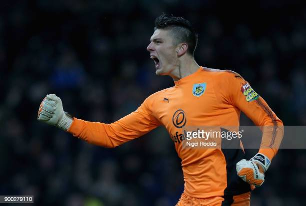 Nick Pope of Burnley celebrates his sides first goal during the Premier League match between Burnley and Liverpool at Turf Moor on January 1 2018 in...