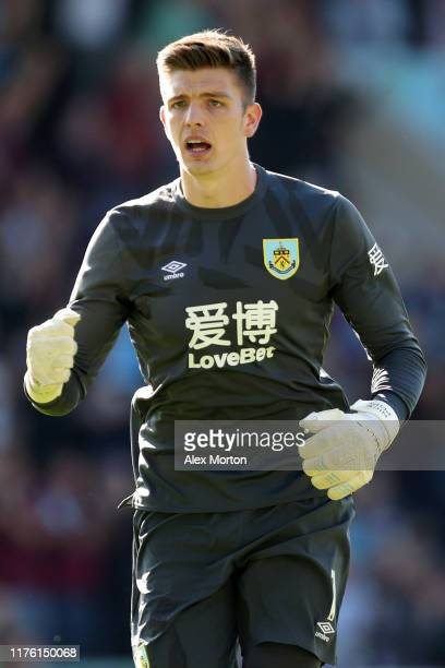 Nick Pope of Burnley celebrates his teams first goal during the Premier League match between Burnley FC and Norwich City at Turf Moor on September 21...