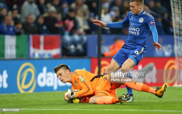 Nick Pope of Burnley claims the ball in front of Jamie Vardy of Leicester City during the Premier League match between Leicester City and Burnley at...