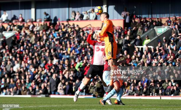 Nick Pope of Burnley clears with his head during the Premier League match between Burnley and Southampton at Turf Moor on February 24 2018 in Burnley...