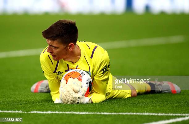 Nick Pope of Burnley collects the ball during the Premier League match between Crystal Palace and Burnley FC at Selhurst Park on June 29 2020 in...