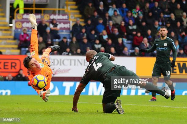 Nick Pope of Burnley dives to save the header of Vincent Kompany of Manchester City during the Premier League match between Burnley and Manchester...