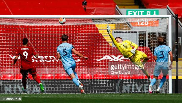 Nick Pope of Burnley fails to make a save as Andy Robertson of Liverpool scores his team's first goal during the Premier League match between...