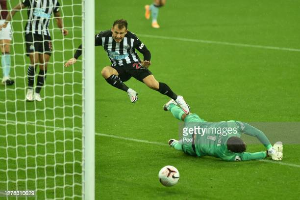Nick Pope of Burnley fouls Ryan Fraser of Newcastle United leading to Newcastle United being awarded a penalty during the Premier League match...
