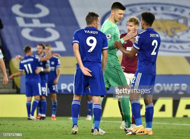 Nick Pope of Burnley interacts with James Justin of Leicester City following the Premier League match between Leicester City and Burnley at The King...