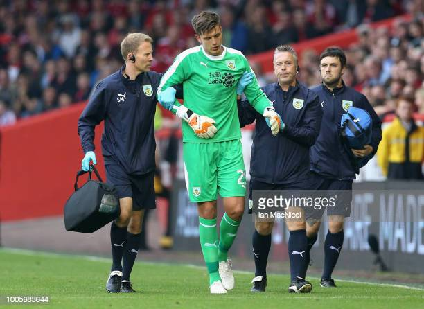 Nick Pope of Burnley limps off the pitch following an injury during the UEFA Europa League Second Qualifying Round 1st Leg match between Aberdeen and...
