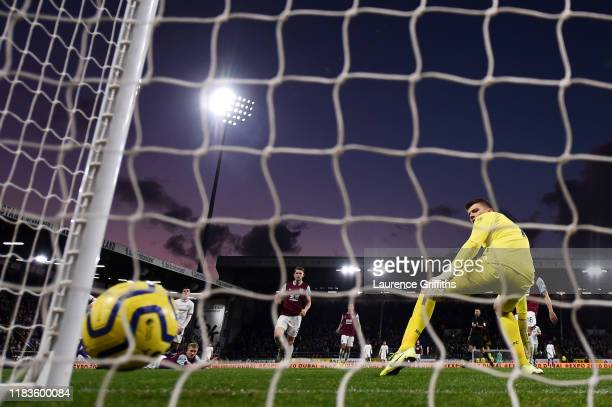 Nick Pope of Burnley looks on as Christian Pulisic of Chelsea scores his team's second goal during the Premier League match between Burnley FC and...