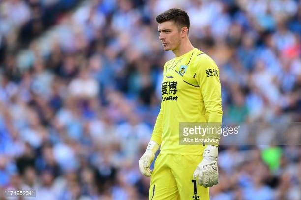 Nick Pope of Burnley looks on during the Premier League match between Brighton Hove Albion and Burnley FC at American Express Community Stadium on...