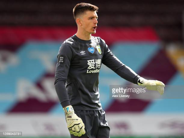 Nick Pope of Burnley looks on during the Premier League match between Burnley FC and Brighton Hove Albion at Turf Moor on July 26 2020 in Burnley...