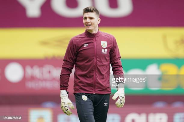 Nick Pope of Burnley looks on during the warm up prior to the Premier League match between Burnley and Arsenal at Turf Moor on March 06, 2021 in...
