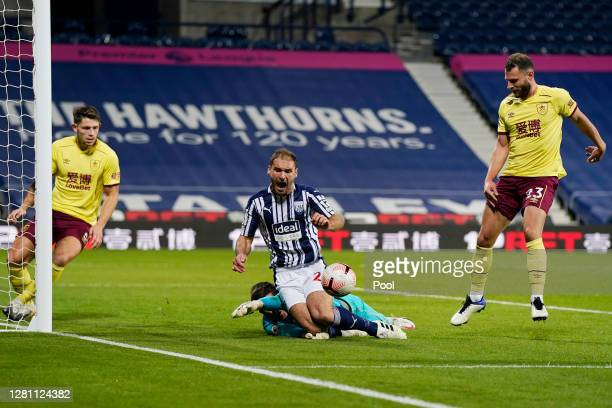 Nick Pope of Burnley makes a save from Branislav Ivanovic of West Bromwich Albion during the Premier League match between West Bromwich Albion and...