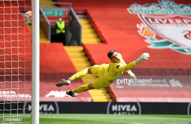 Nick Pope of Burnley reacts whilst he attempts to make a save as Andy Robertson of Liverpool scores his team's first goal during the Premier League...