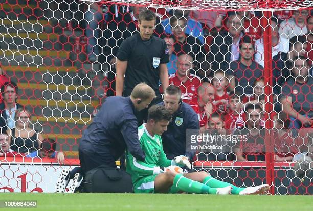 Nick Pope of Burnley recieves treatment following an injury during the UEFA Europa League Second Qualifying Round 1st Leg match between Aberdeen and...