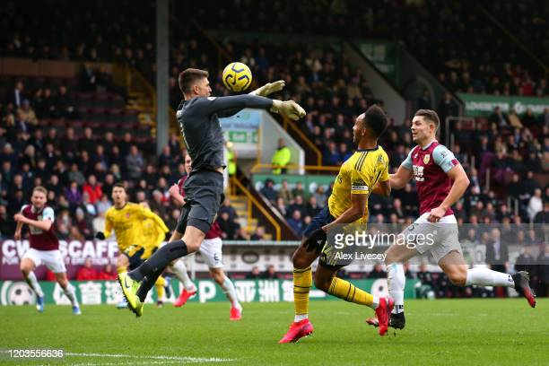 Nick Pope of Burnley saves a shot from PierreEmerick Aubameyang of Arsenal during the Premier League match between Burnley FC and Arsenal FC at Turf...
