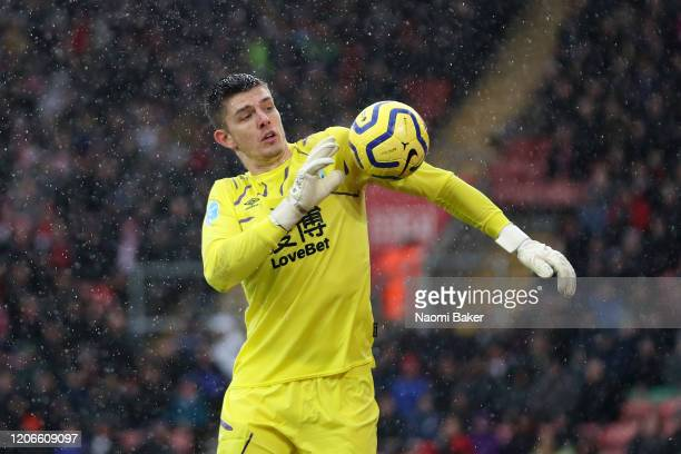 Nick Pope of Burnley shoulders the ball during the Premier League match between Southampton FC and Burnley FC at St Mary's Stadium on February 15...
