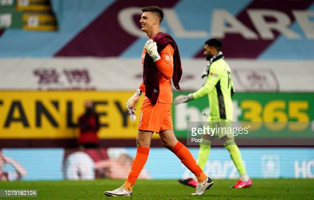 Nick Pope of Burnley smiles before the penalty shootout during the Carabao Cup second round match between Burnley and Sheffield United at Turf Moor...