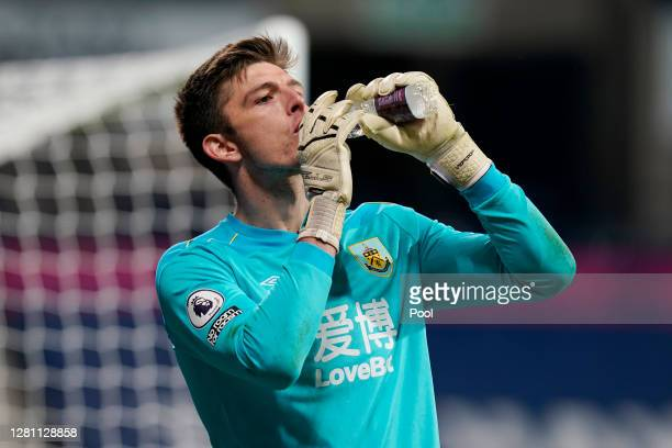 Nick Pope of Burnley takes a drink during the Premier League match between West Bromwich Albion and Burnley at The Hawthorns on October 19 2020 in...