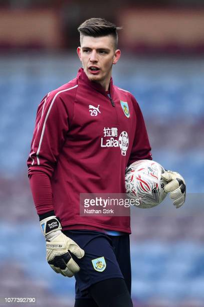 Nick Pope of Burnley warms up prior to the FA Cup Third Round match between Burnley and Barnsley at Turf Moor on January 5 2019 in Burnley United...