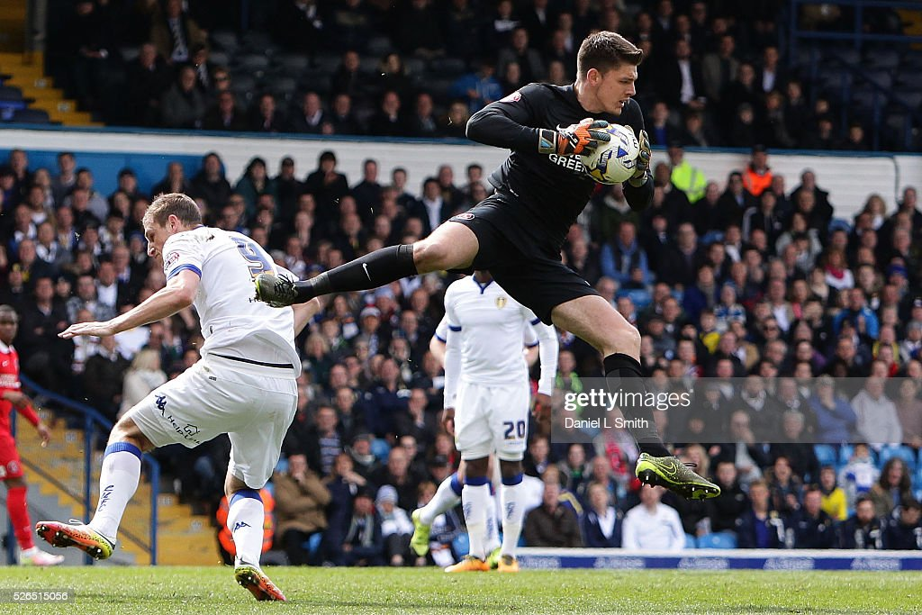 Nick Pope of Charlton Athletic FC saves the ball from Chris Wood of Leeds United FC during the Sky Bet Championship match between Leeds United and Charlton Athletic at Elland Road on April 30, 2016 in Leeds, United Kingdom.