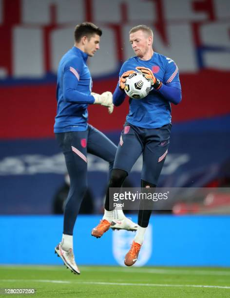 Nick Pope of England and Jordan Pickford of England warm up ahead of the UEFA Nations League group stage match between England and Denmark at Wembley...